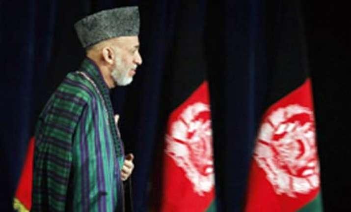 impostor posing as taliban mullah meets karzai