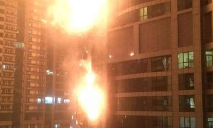 building in dubai s marina district in flames