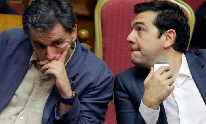greek lawmakers pass austerity bill despite dissent