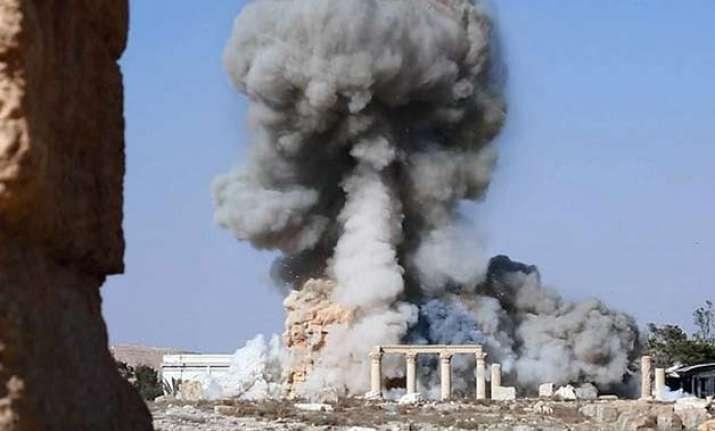 islamic state militants tie captives to palmyra columns