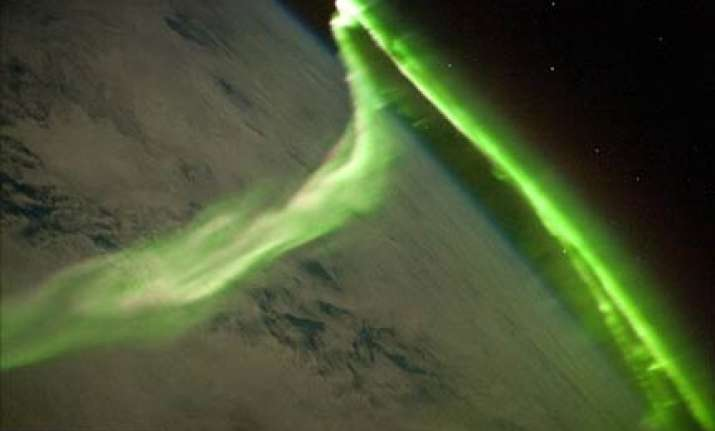 stunning green glow of southern lights as seen from space