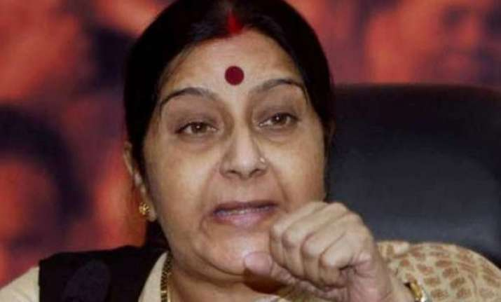 sushma swaraj meets counterparts from nepal sri lanka