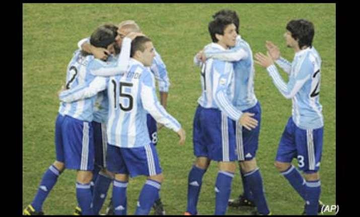tevez double puts argentina into last eight