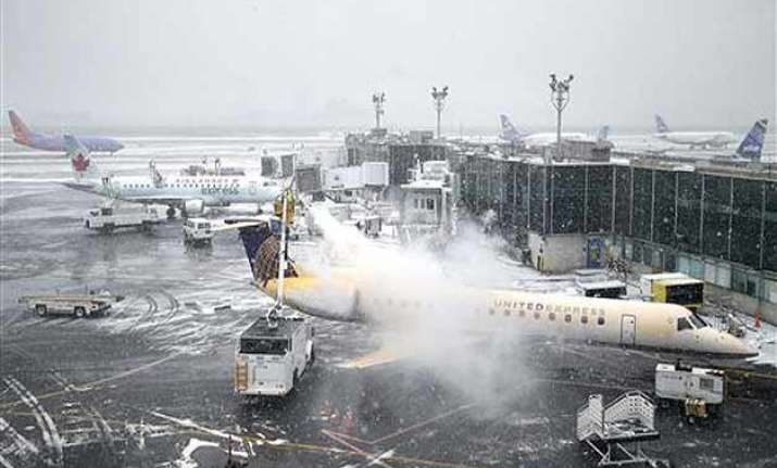 thousands of flights canceled as us braces for blizzard