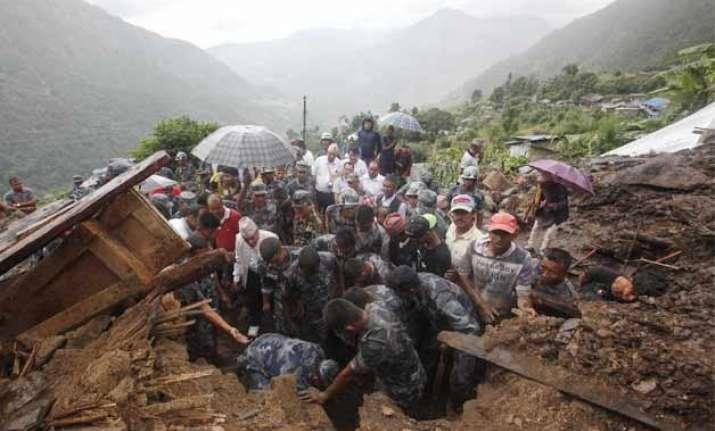 landslides bury nepal villages killing at least 30 people
