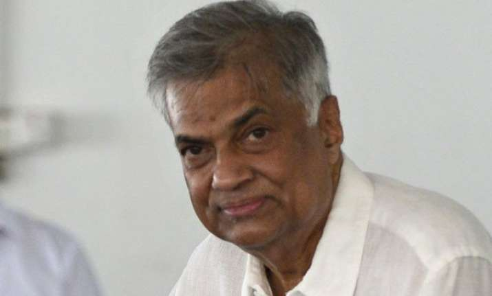 sri lanka s prime minister sworn in as 2 parties sign deal