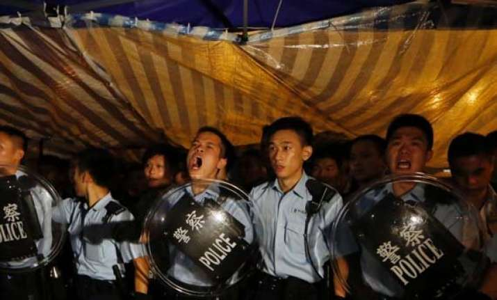 hong kong police move in against protest zone
