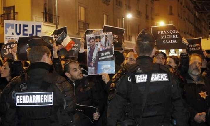 france hunts suspect prepares for mass anti terror rally