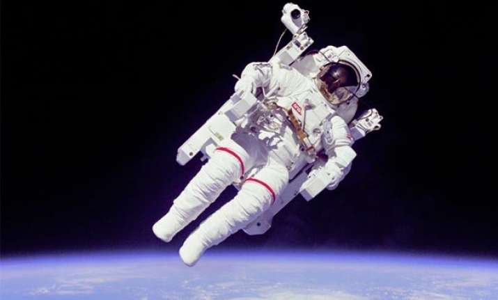 spacewalking astronauts capture footage of their work on iss