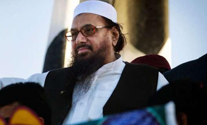 hafiz saeed defends lakhvi claims he is innocent