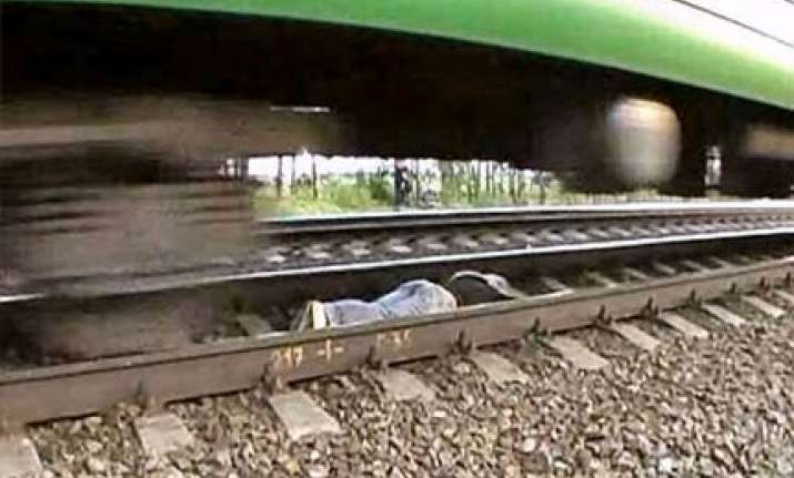 russian girl lies on tracks as train speeds over her