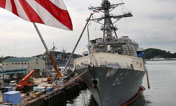 china warns us navy after ship sails by chinese built island