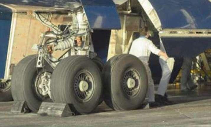 vienna to london romanian survives 41c hiding in plane s