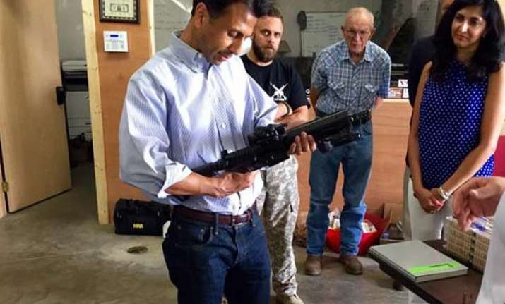 bobby jindal mocked for posing with gun at campaign stop