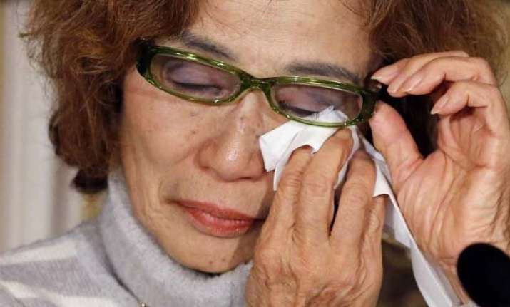 mother of is held japanese hostage calls for release of son