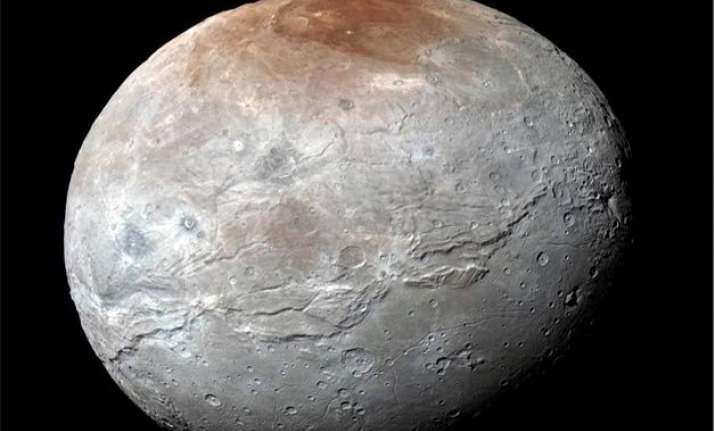 nasa releases pluto s moon charon in eye catching detail