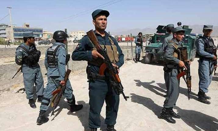 car bombing kills at least 26 civilians near afghan base