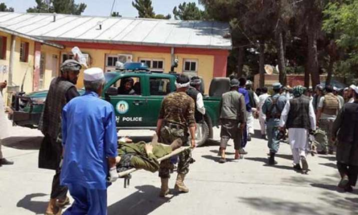 suicide bomber kills 19 people in north afghanistan market