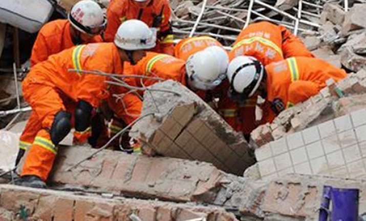 9 storey building collapses in china 16 people missing