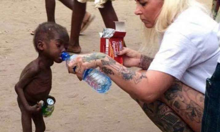 heart breaking starved nigerian toddler saved by a young