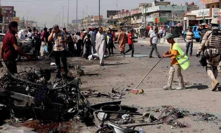 iraq officials huge truck bomb in baghdad market kills 54