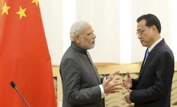 india china vow to settle border issue at earliest