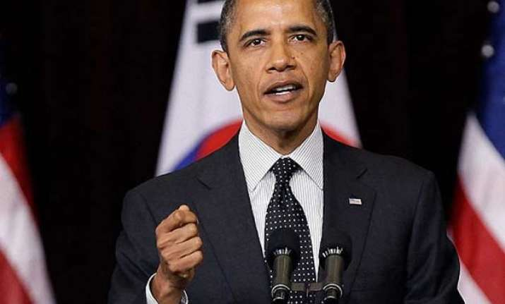 obama condemns ferguson gunmen who shot cops says there is