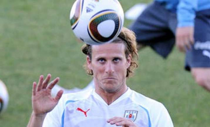 forlan powers uruguay past south africa