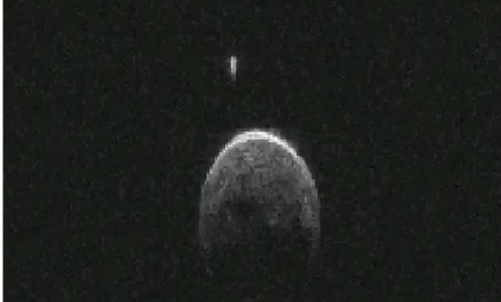 asteroid that flew past earth has small moon