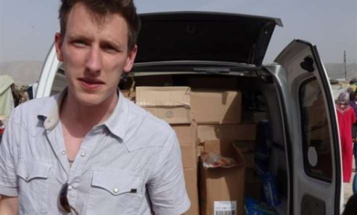 us aid worker s parents plead for his release