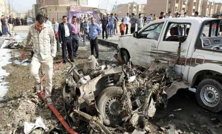 bombs in iraq including twin blasts on busy street kill 23