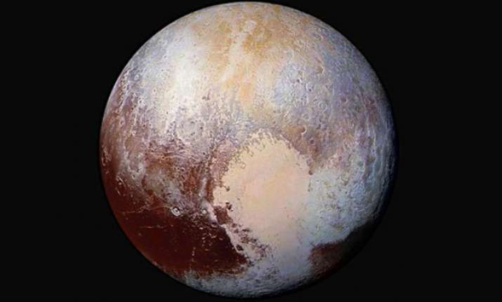 conditions on pluto incredibly hazy with flowing ice