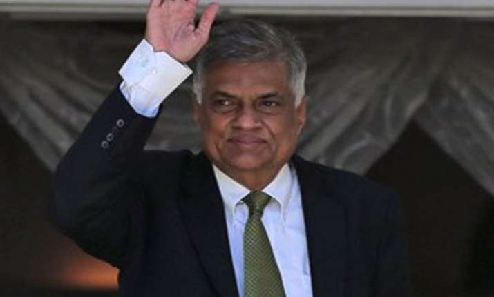 ranil wickremesinghe vows to work with rivals to build