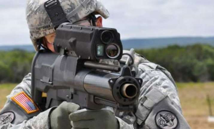futuristic us army rifle uses radio controlled bullets that