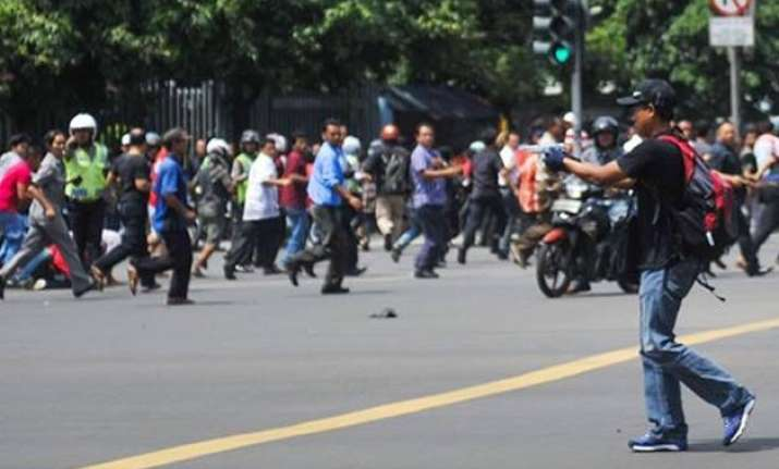 in pics multiple blasts rock jakarta city seven dead