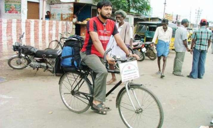 indian cyclist reaches qatar on 200 000 km trip
