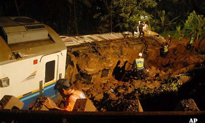 indonesia train derails in landslide three dead