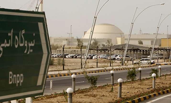 defiant iran loads indigenous fuel rods into reactor