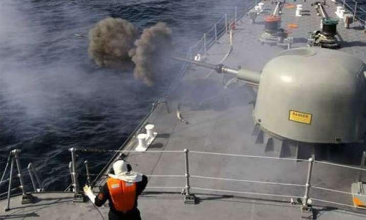 iran begins naval maneuvers near strait of hormuz