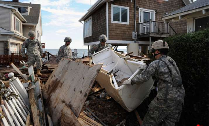 irene s death toll rises to 46 u.s. towns battle floods