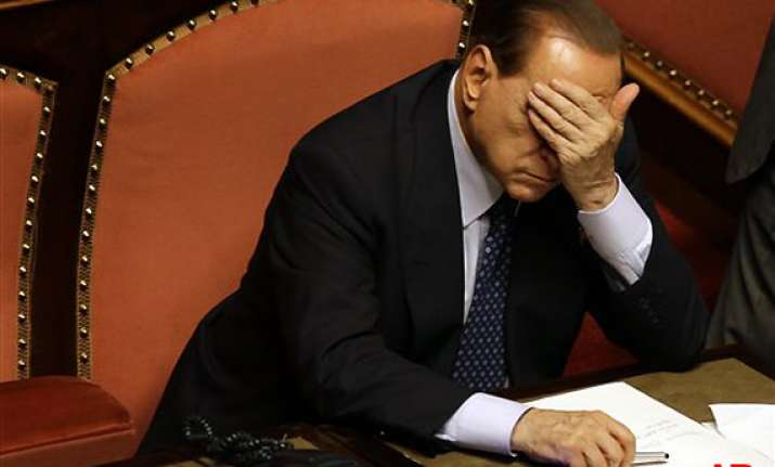 italian court sets two year political ban for berlusconi