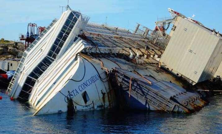 italy s sunken ship towed away