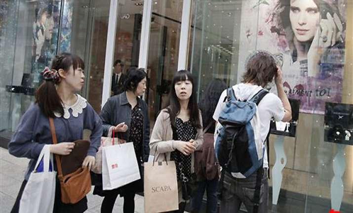 japan s economy rises out of earthquake slump