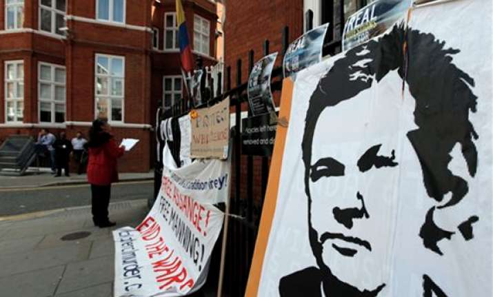 julian assange not leaving embassy says wikileaks