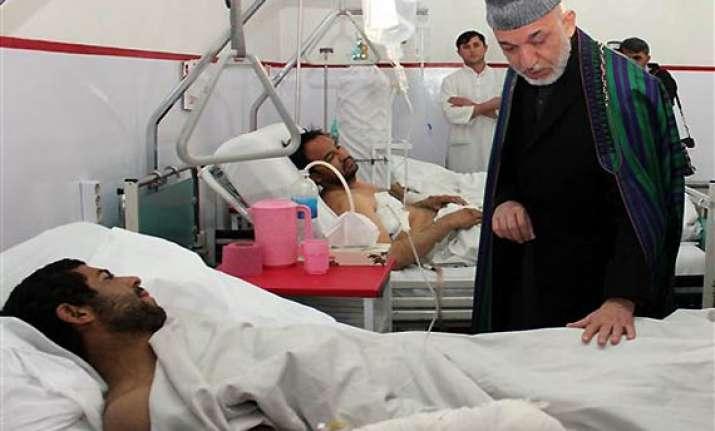 kabul hits back at pakistan over shrine bomb