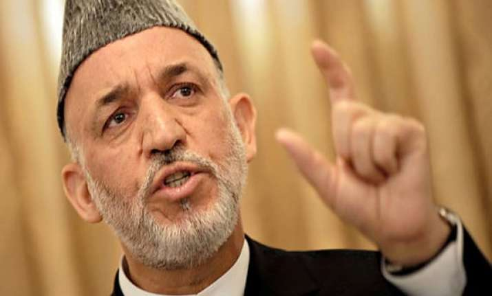karzai arrives in pakistan on day long visit