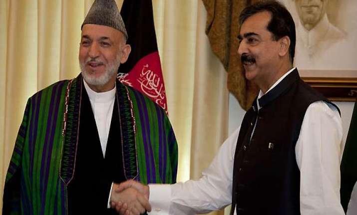 karzai calls gilani asks him to reconsider bonn boycott