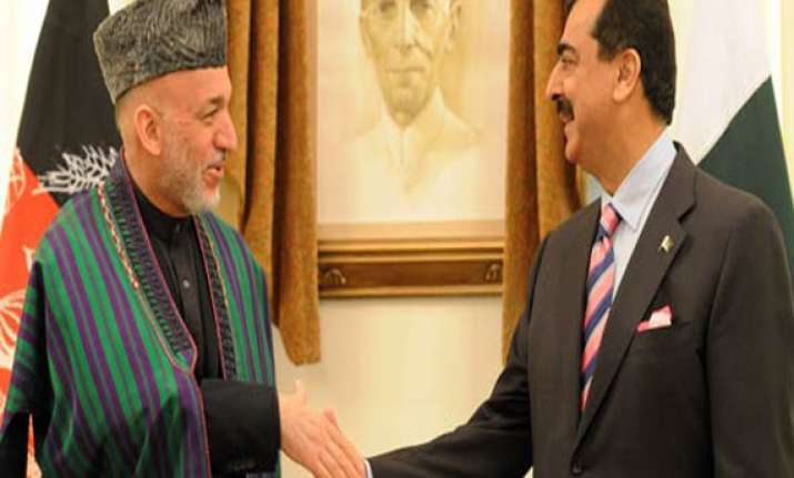 karzai confronts gilani demands pak produce taliban leaders