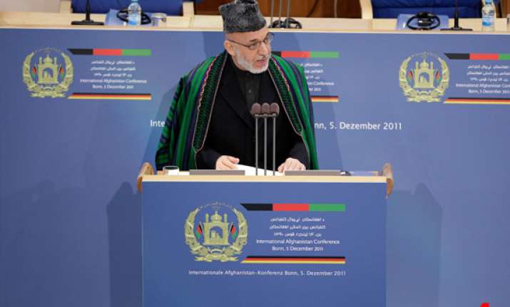 karzai will try to hold on to power beyond 2014 report