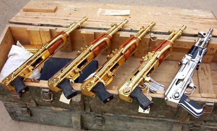 know saddam hussein s passion for golden guns in pics